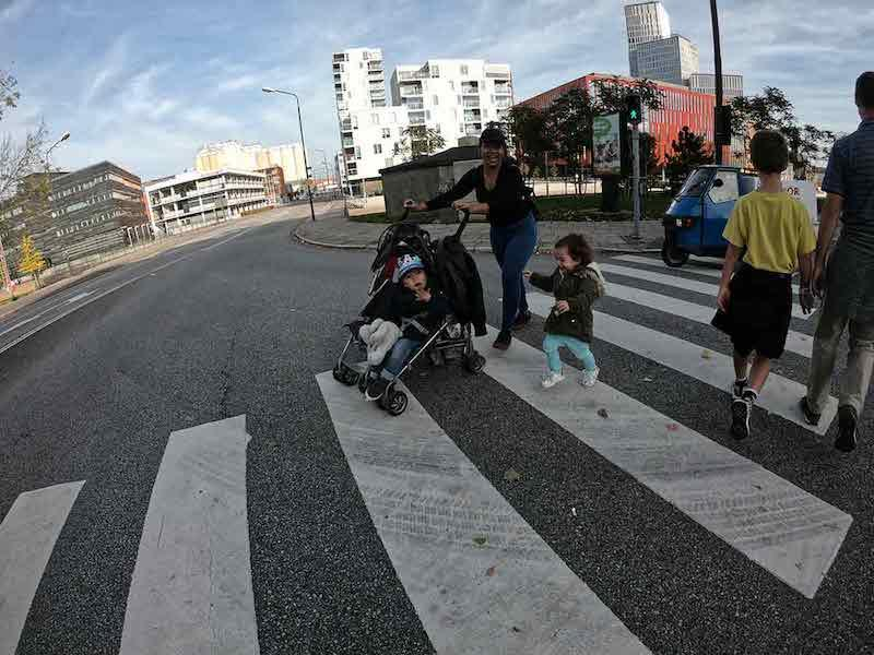 Family with stroller in crosswalk