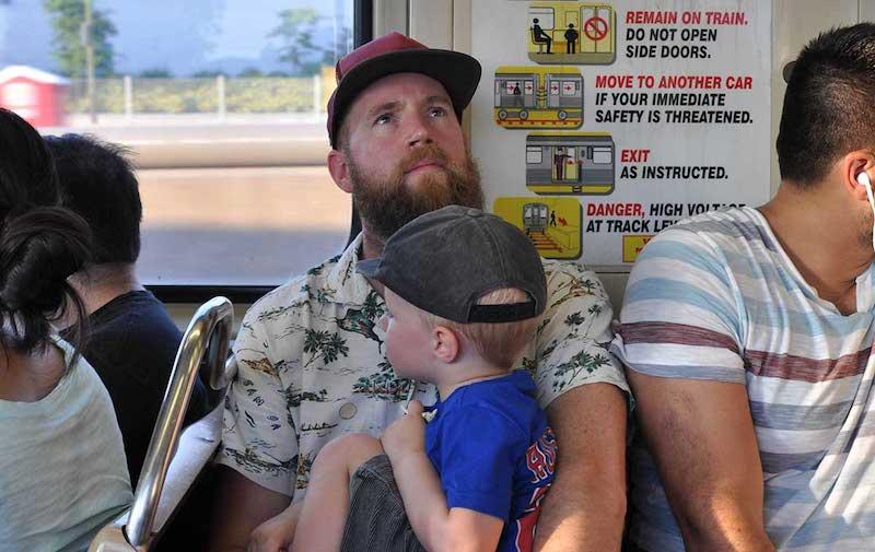 Father and son on train