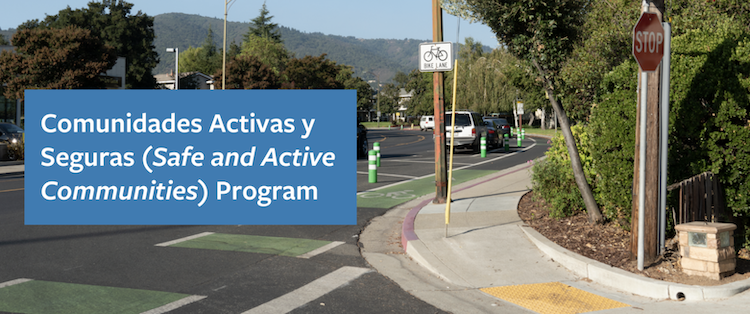 Banner photo of the Safe and Active Communities Program with the program name on a blue background, superimposed on a photo of a residential street corner with a bike lane