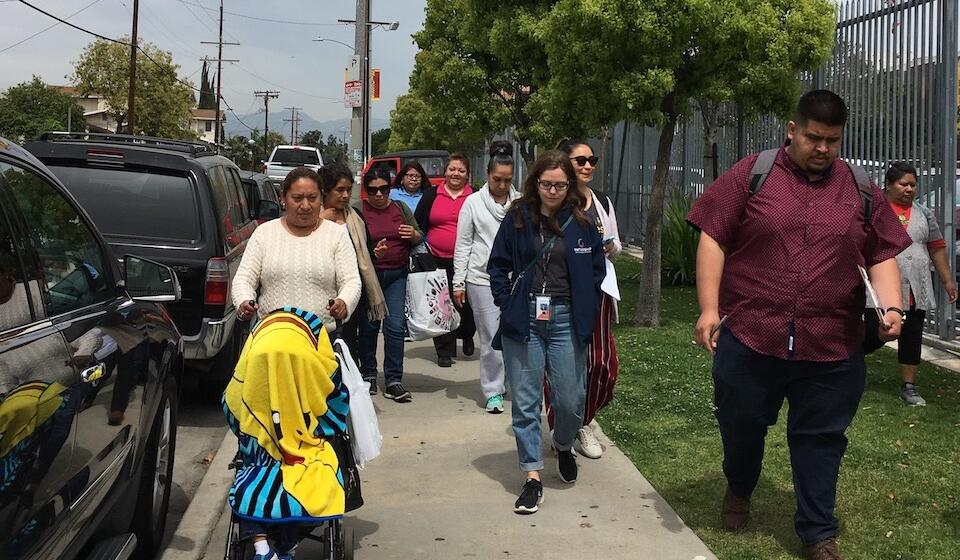 The planning committee conducting the walking assessment during the Boyle Heights CPBST Site Visit.