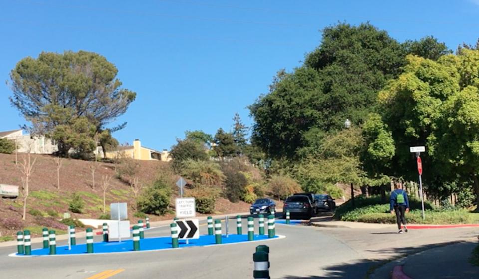 Pedestrian walking near a roundabout in Hercules, CA