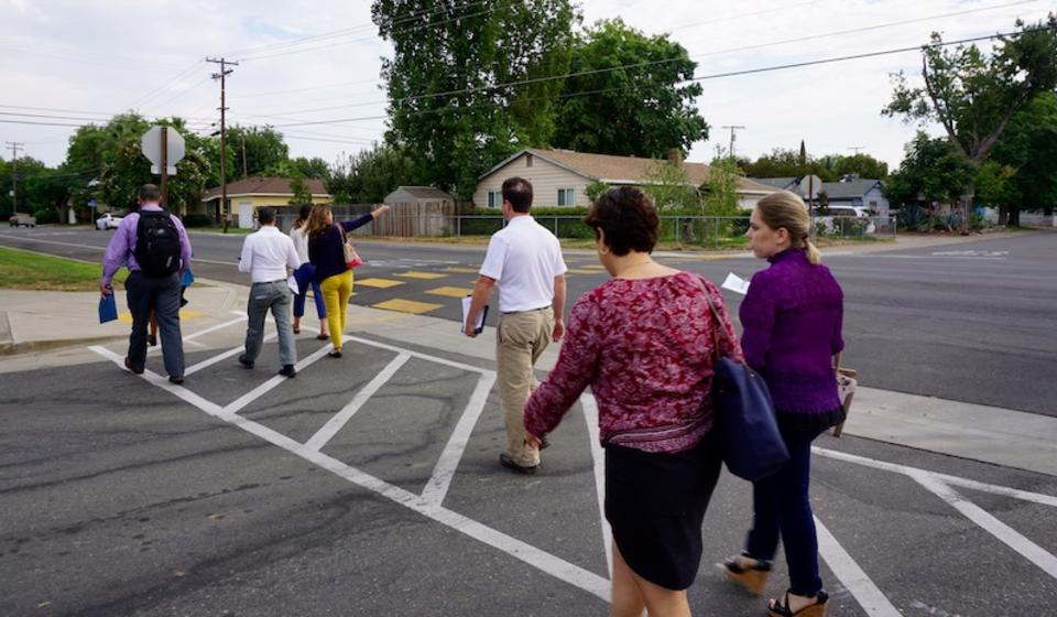 Workshop participants cross street in Rancho Cordova