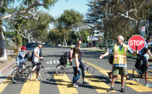 Parents and children in crosswalk in Pomona
